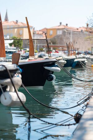 Fishing and tourist boats moored to the pier Banco de Imagens