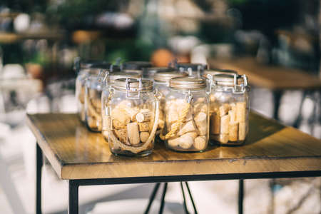 Vintage jars with corks from wine inside