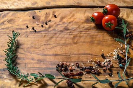 Food cooking wood background, ingredients for preparation vegan dishes, tomatos Banco de Imagens