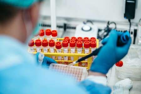 The PCR tester takes a sample analysis from a test tube