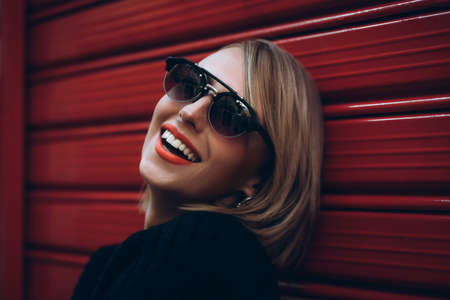 Young girl with beautiful teeth in glasses laughs