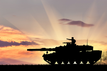 barrel bomb: Concept of war. Silhouette of a tank with a soldier at sunset