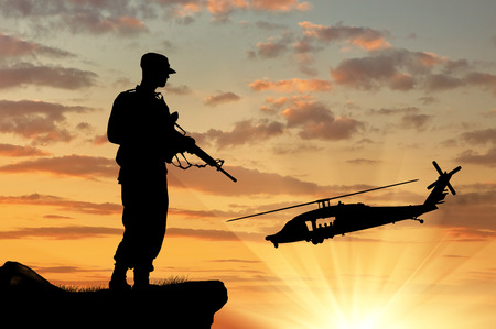 power rangers: Silhouette of a soldier and helicopter at sunset