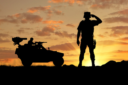 power rangers: Silhouette of a soldier and a combat vehicle Humvee at sunset