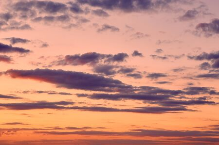 tinge: Beautiful cloudy evening sky with sun rays with purple tinge Stock Photo