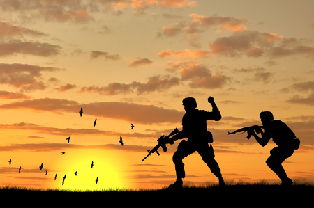 afghan: Silhouette of two soldiers on exploration at sunset Stock Photo