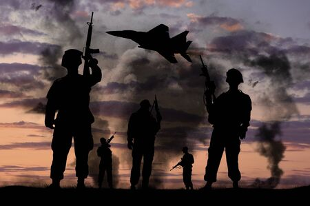 soldier: Concept of war. Silhouettes of military soldiers with guns and fighter against the backdrop of explosions and smoke