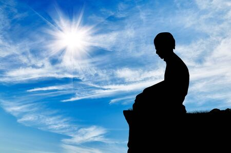 islamic pray: Islamic religion. Silhouette of man praying at the top on a background cloudy sky