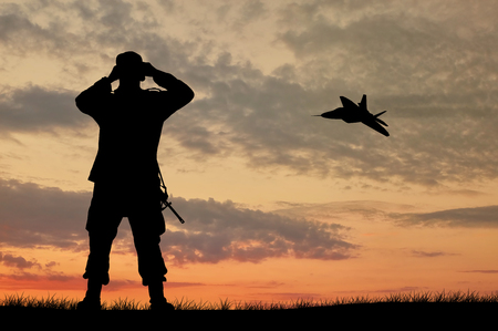 power rangers: Silhouette of a soldier and an airplane looking through binoculars at sunset
