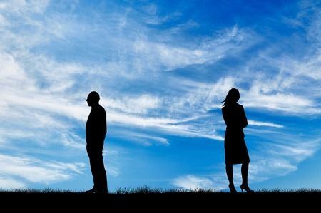 sulk: Concept of relationship. Silhouette of the gap between men and women in quarrel against the background of the sunny sky