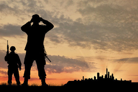 Silhouette of two soldiers with guns looking through binoculars over the city at sunset