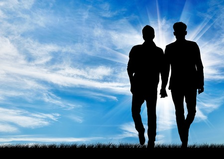 Silhouette of two gay men walking holding hands