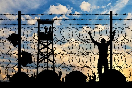 middle east crisis: Concept of refugee. Silhouette refugee camps with tents, amid watch tower and a barbed wire fence
