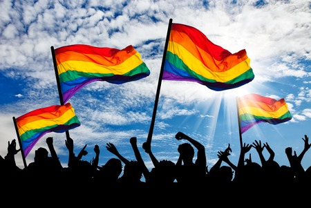 Silhouette of a parade of gays and lesbians with a rainbow flag