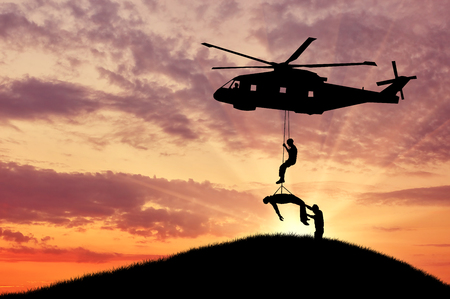 special operations: Concept of the evacuation. Silhouette helicopter evacuated the wounded man Stock Photo