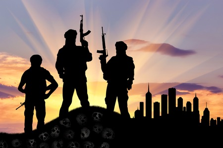corpses: Concept of terrorism. Silhouette of terrorists with a rifle standing on a pile of skulls on the background of evening city Stock Photo