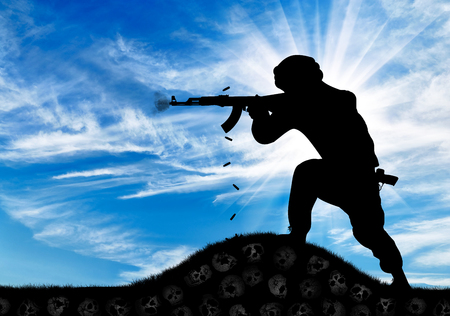 gunman: Concept of a terrorist. Silhouette of a terrorist attack gunman with a rifle and the land of skulls