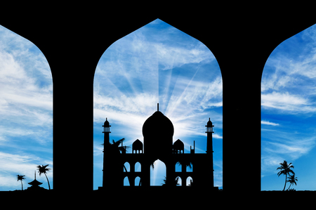 islamic pray: Silhouette of an Islamic prayer hall-house in the beautiful sky Stock Photo