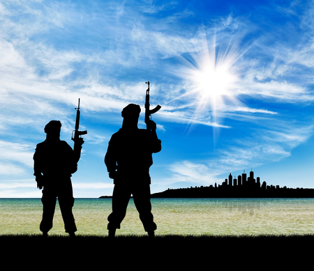 corpses: Concept of a terrorist attack. Silhouette of terrorists with a rifle on a background of the city
