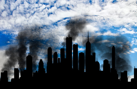 corpses: Concept of a terrorist attack. Silhouette of the city in smoke against the blue sky