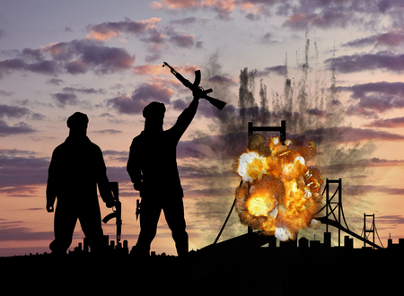 blow up: Concept of terrorism and acts of terrorism. Silhouette of terrorists and blow up the bridge at sunset