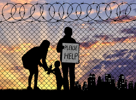 illegals: Concept of the refugees. Silhouette of a refugee family with a child near the fence at sunset asking for help