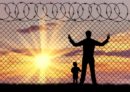 illegals: Concept of the refugees. Silhouette of father and child refugees against the background of the fence