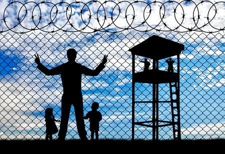 hungry children: Concept of the refugees. Silhouette refugees father and two hungry children on the background of the fence and watchtower Stock Photo