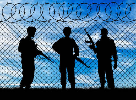 war: Concept of war. Silhouette of the military near the border against the sky Stock Photo