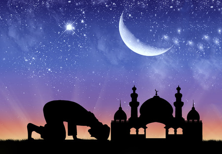 oncept: ?oncept of the Islamic religion. Silhouette of the town hall and praying men on the background of the starry sky and the moon