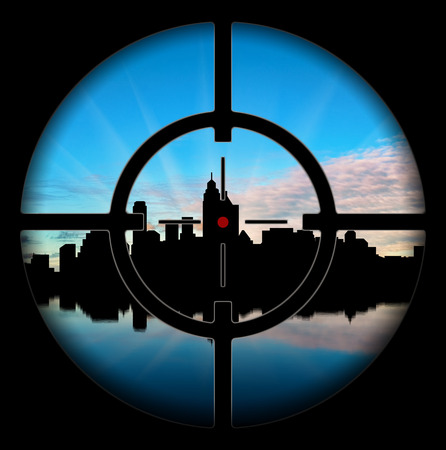 oncept: ?oncept of terrorism. Silhouette of the city at gunpoint on a background of dawn Stock Photo