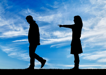 deceit: Concept of deceit and betrayal. Silhouette woman breaks the relationship with a man for treason against the sky Stock Photo