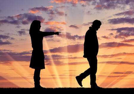 treason: Concept of deceit and betrayal. Silhouette woman breaks the relationship with a man for treason against the sunset Stock Photo