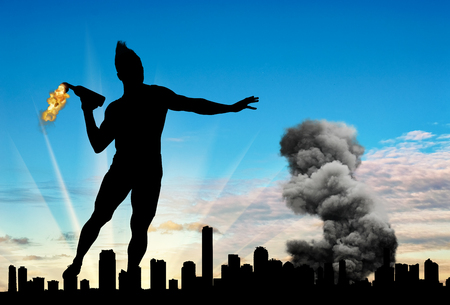 molotov: Concept of military conflict. Silhouette of a man throwing a Molotov cocktail against the background of the city in smoke