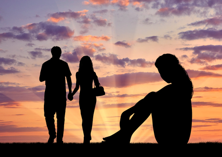 condemnation: Concept of betrayal and treason. Silhouette of a lonely woman looking at loving couple at sunset
