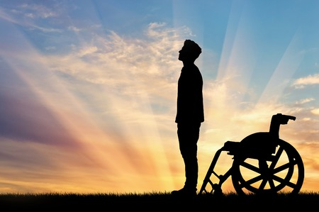 crippled: Concept of disability and disease. Silhouette of disabled person who stood out of the wheelchair on the sunset background Stock Photo