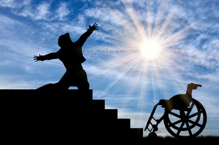 Concept of disability and positive. Silhouette of disabled person to experience happiness at the top of the stairs daytime Stock Photo