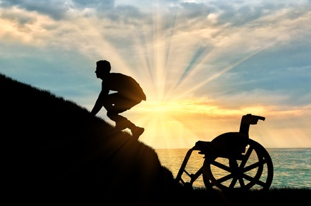 crippled: Concept of disability and self-motivated. Silhouette of disabled person to climb the hill on a background of sea sunset