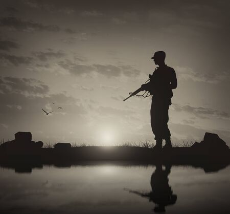 Concept of terrorism and war. Silhouette of a terrorist with a weapon  and reflection Stock Photo