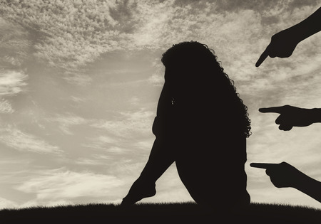 deceit: Concept of deceit and betrayal. Silhouette of a woman and condemning the hands of people against the sky