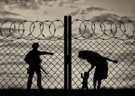 middle east crisis: Concept of the refugees. Silhouette refugee mother with a baby and a border guard at sunset