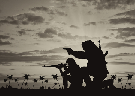 terrorists: Concept of terrorism. Silhouette of a terrorists with a rifle on a background of sunset and palm trees