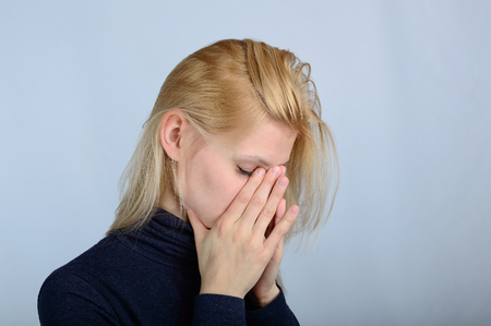 experiencing: Concept of emotions and feelings. A woman experiencing stress and pain Stock Photo