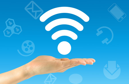 signal device: Wi fi concept. Wi fi icon in the mans hand Stock Photo