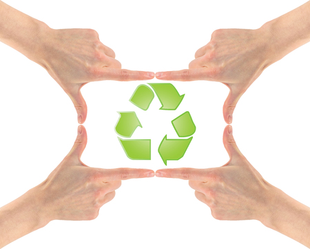 Concept of plastic recycling. Recycling symbol in the center of the four hands