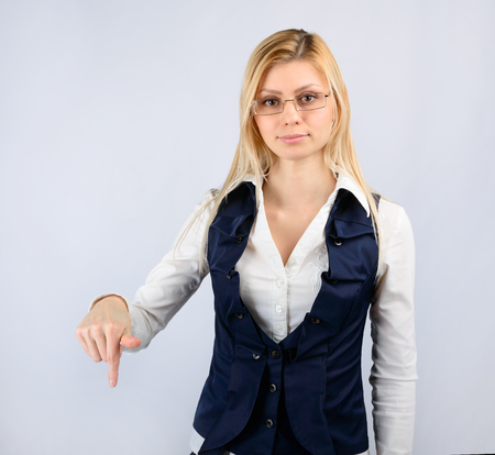 reprimand: Concept of a reprimand and fall. Business woman in a suit shows thumb down Stock Photo