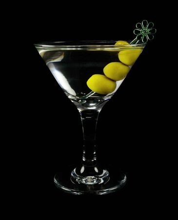 sweet vermouth: Martini cocktail with olives on a black background closeup