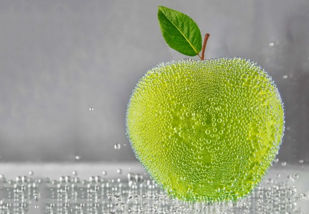 Green apple in water. design element Фото со стока