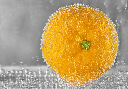 Juicy orange fruit in water. design element Фото со стока