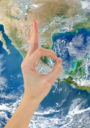 nasa: Concept of globalization. Ok hand gesture against the backdrop of the planet Earth NASA